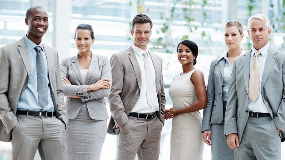 Image of professionals standing near each other in an corporate setting