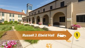 Stop 1 Lourdes Drive Thru Tour - Russell Ebeid Hall