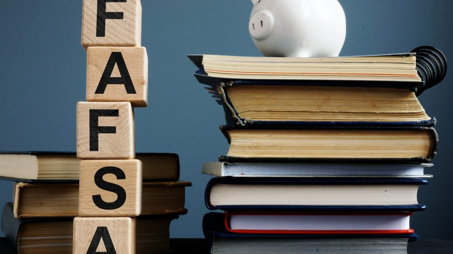 FAFSA image with books, a piggy bank with FAFSA spelled in building blocks