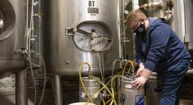Craft Beverages major working at internship site in brewery