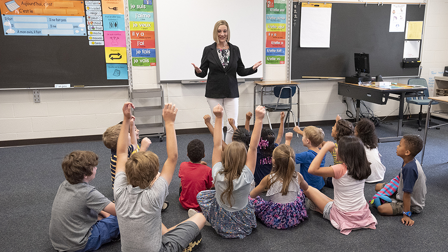 Photo of Young Students With Educator In Classroom
